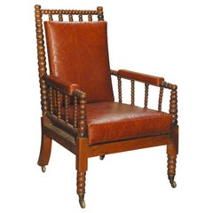 Bobbing turned English rosewood armchair with cane seat