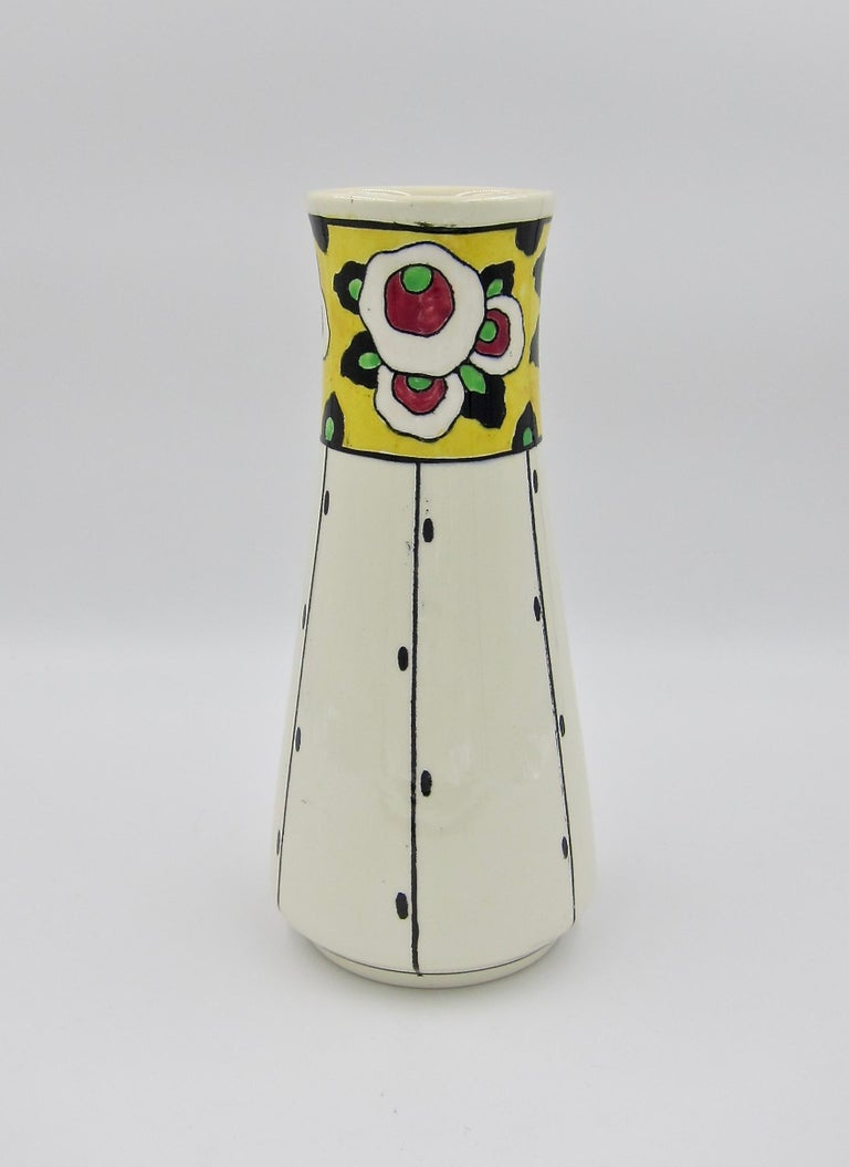 A colorful Art Deco vase produced by Boch Freres, Charles Catteau's l'Atelier de Fantaisie art pottery workshop at La Louvière, Belgium, circa 1923.   Boch Freres produced a notable range of bold and colorful ceramics during the Art Deco period,