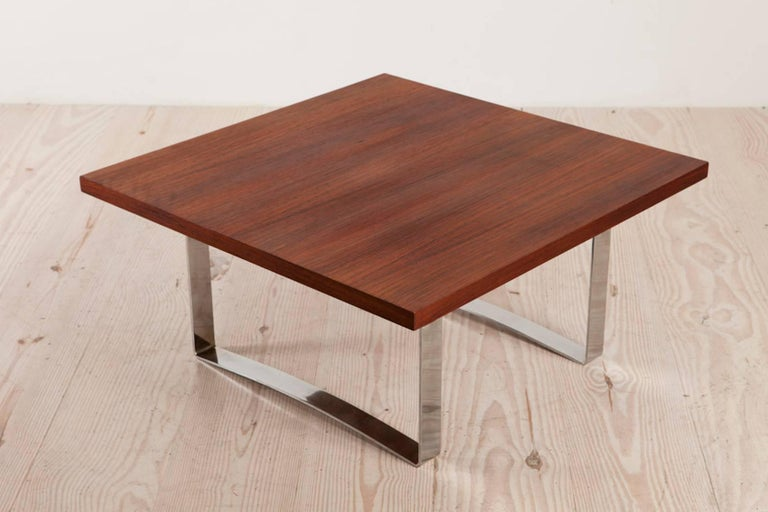 Bodil Kjaer (1932 Denmark - 1960), rare, low, square rosewood coffee table with chromed steel frame, circa 1959. The square rosewood top on two chromed steel U-form legs.