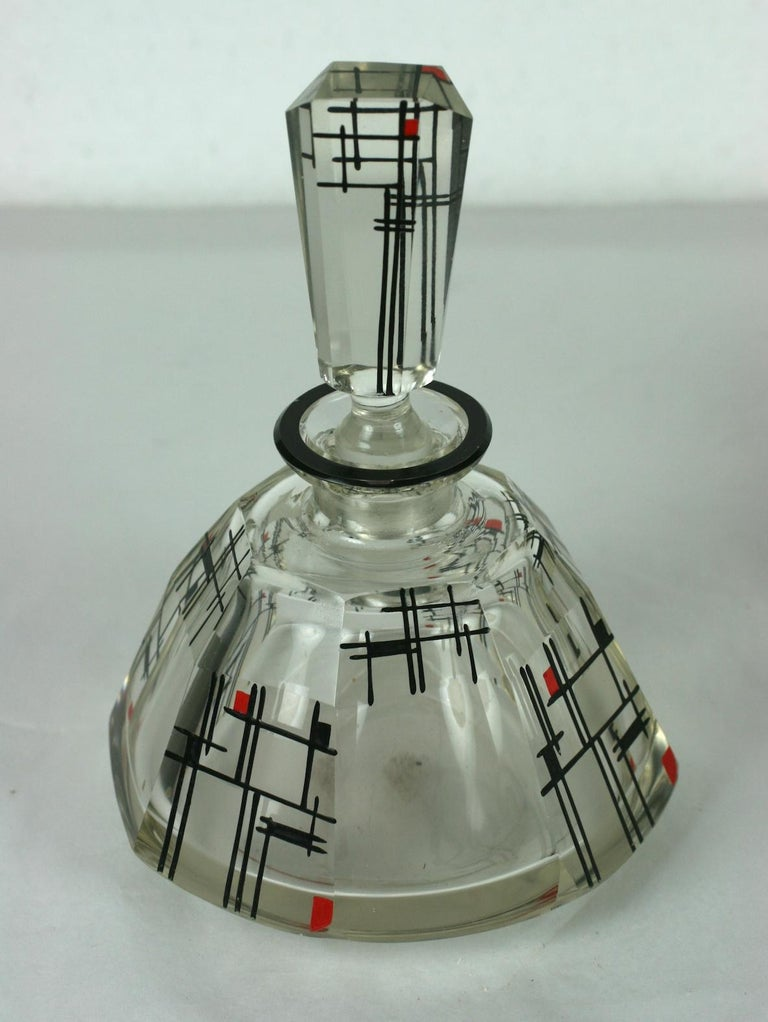 Karl Palda Art Deco crystal vanity suite, circa 1925. Both decorated with acid etched frosted squares with red and black Modrianesque motifs.  Consisting of two faceted bottles, one a perfume with tall stopper, the other an atomizer with chrome