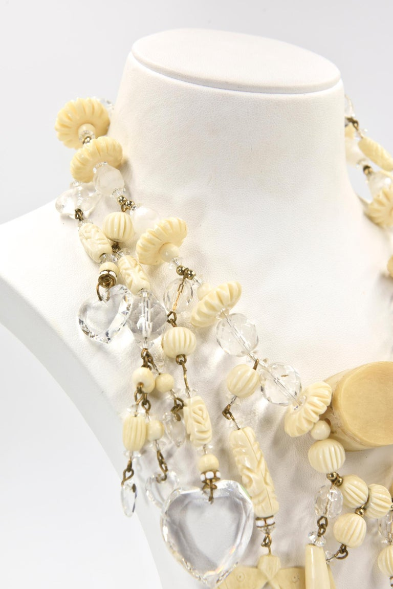 Bohemian Chic Carved Bone and Lucite Hearts Bib Necklace with Dangling Earrings  In Good Condition For Sale In Miami Beach, FL