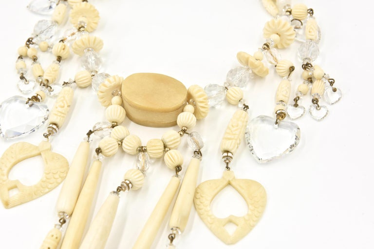Bohemian Chic Carved Bone and Lucite Hearts Bib Necklace with Dangling Earrings  For Sale 1