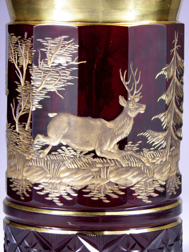 Ruby glass, handcut Gilded engraving with hunting motive.
