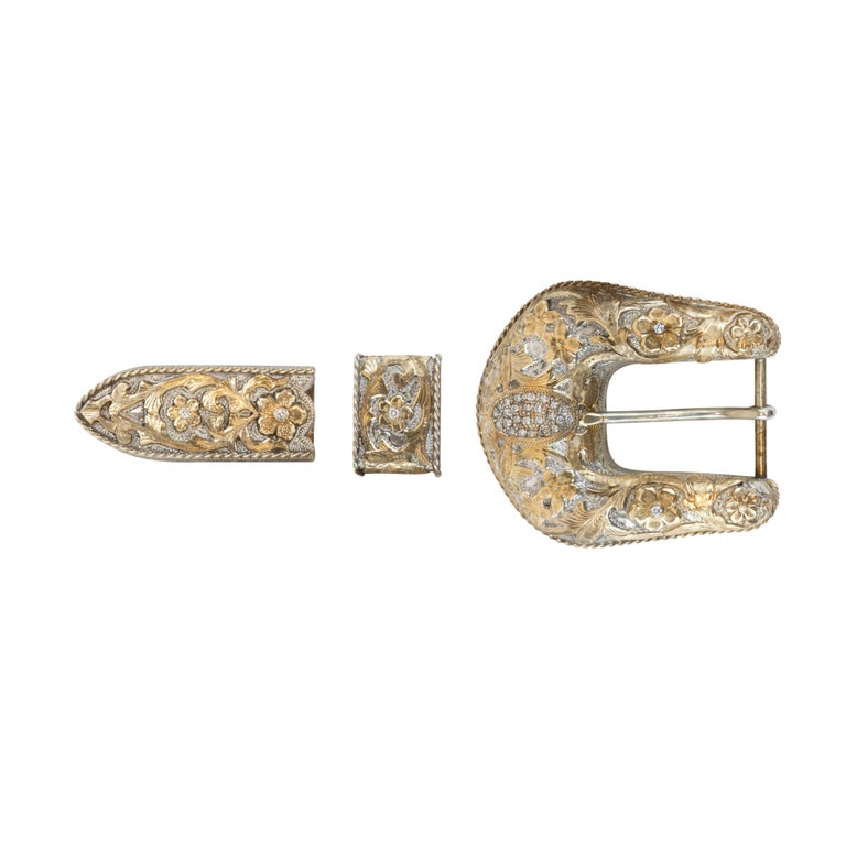 Edward H. Bohlin three -piece custom ordered belt buckle set. Very fine 14k gold over sterling silver with inlaid diamonds. Fits a 1