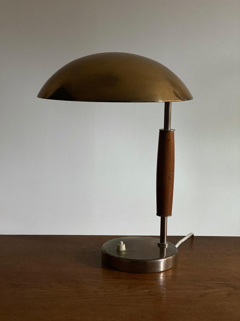 A modernist table lamp or desk light. Production attributed by the iconic Swedish lamp maker Böhlmarks, circa 1940.   Other designers of the period include Paavo Tynell, Lisa Johansson-Pape, Carl-Axel Acking, and Gunnar Asplund.