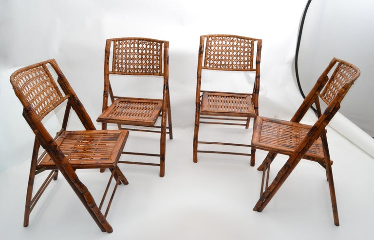 Set of 4 Bohemian style Mid-Century Modern handcrafted bamboo and cane folding chairs. The Bistro chairs are comfortable, sturdy and easy to store. The matching Bistro table is in our other Listings, Ref:LU886321644932. Please take a