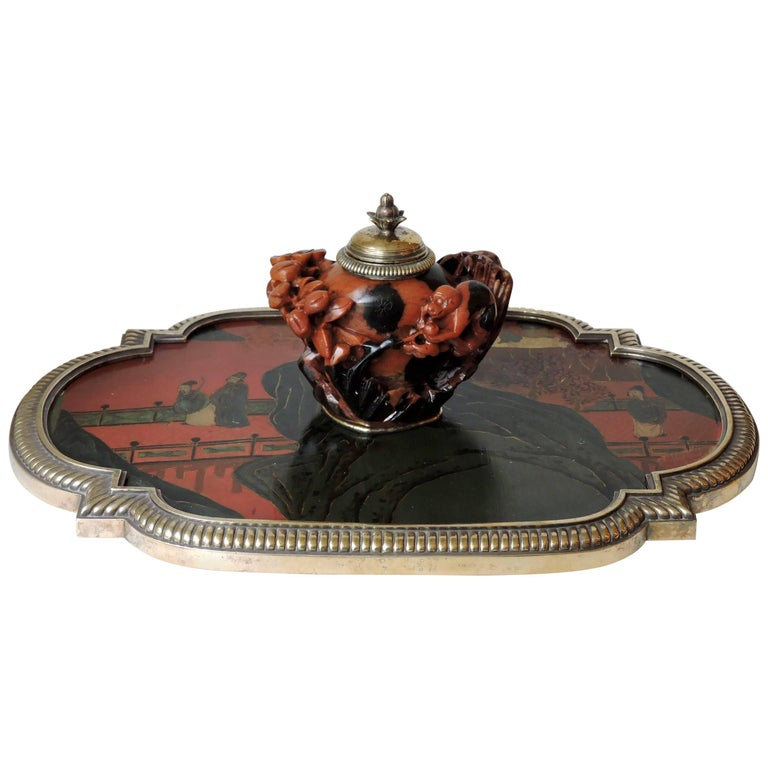 Open- worked carved monkey design soapstone inkwell (steatite) Resting on a red and gold china lacquer tray designed with characters on a bridge. Mount of tray and inkwell bronze godrons Signed Boin-Taburet in Paris and Numbered 78878 53, circa
