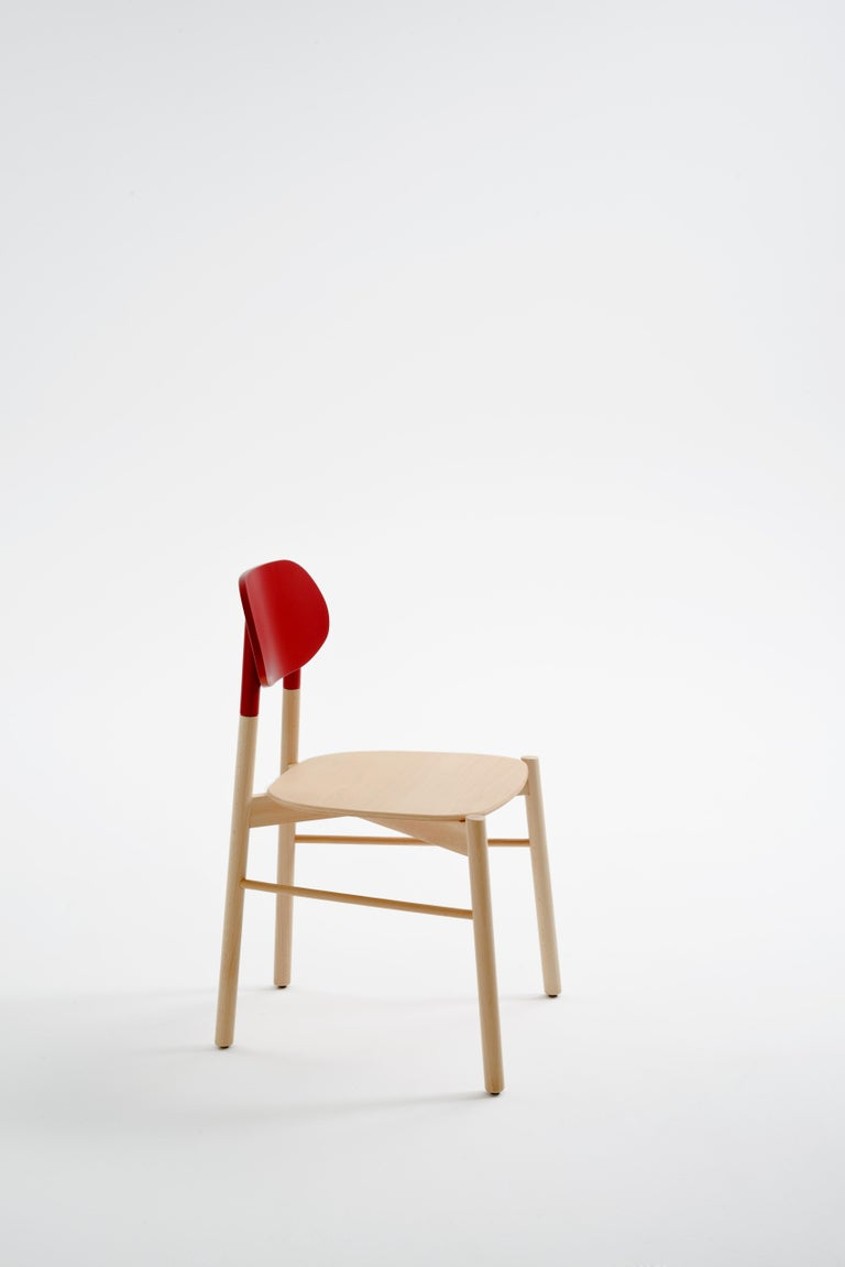 An essential chair in the form, yet precious in colors. Tapered and elongated, the legs of the seat are inspired by the bokken, a wooden replica of the Japanese sword used in the training of the Japanese martial art of Aikido and Kendo.