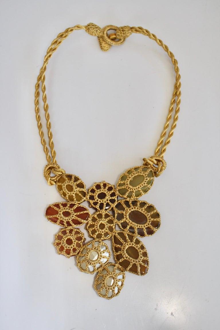 Lurex, rayon, Swarovski crystal, yellow calcite, agate, cornelian, Murano glass, and amber statement necklace. 20