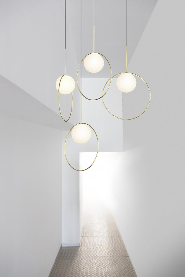Taking its inspiration from pendant jewelry, Bola Halo is a uniquely expressive pendant light featuring a chromated ring that balances delicately over its elegant opal glass shade while allowing its surroundings to shine through. Available in 3