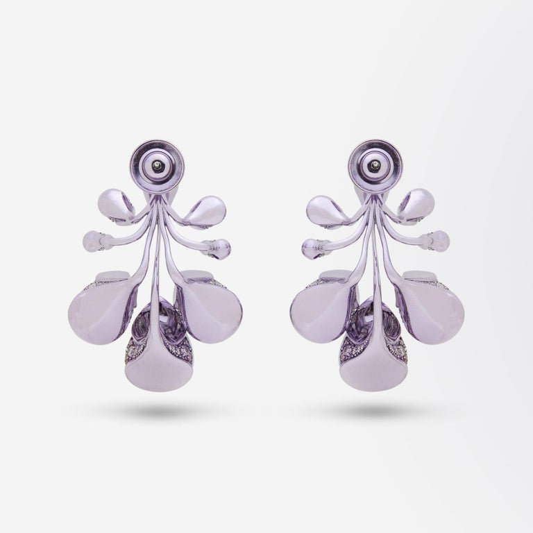 A pair of 18 karat purple plated white gold, lavender jade, amethyst, diamond and tourmaline drop earrings. This pair of versatile earrings feature a detachable central 'drop' earring comprising of a piece of pear shaped cabochon lavender jadeite