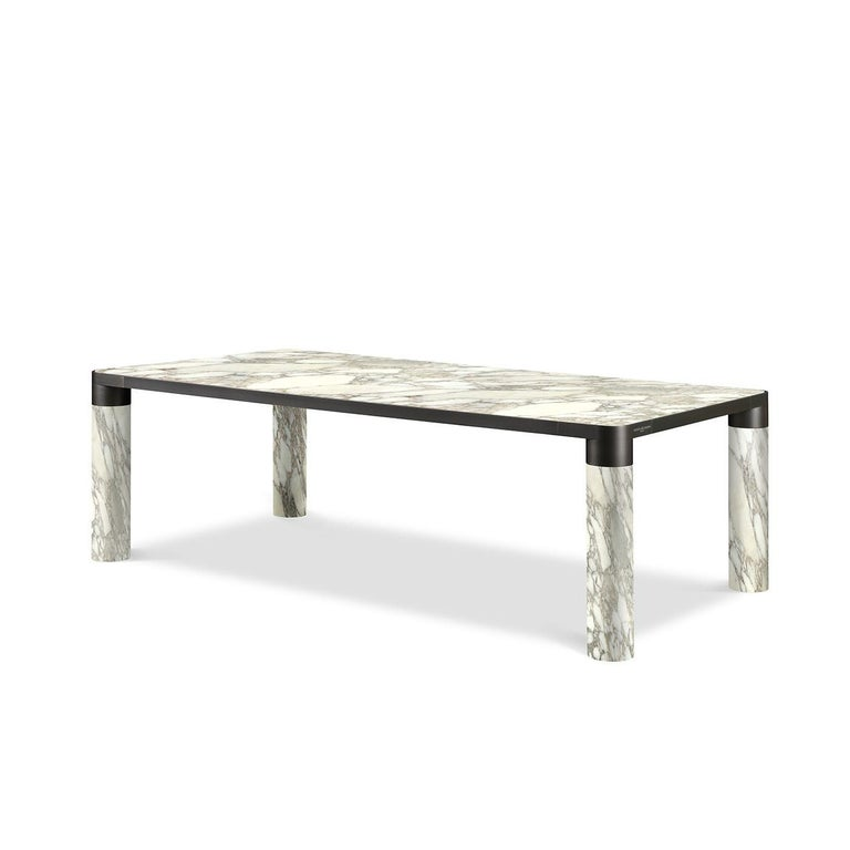 A stunning combination of noble materials and elegant hues, this dining table flaunts a minimalist and bold silhouette that will be an eye-catching focal point in a contemporary dining room. Marked by a classic rectangular shape, it features four
