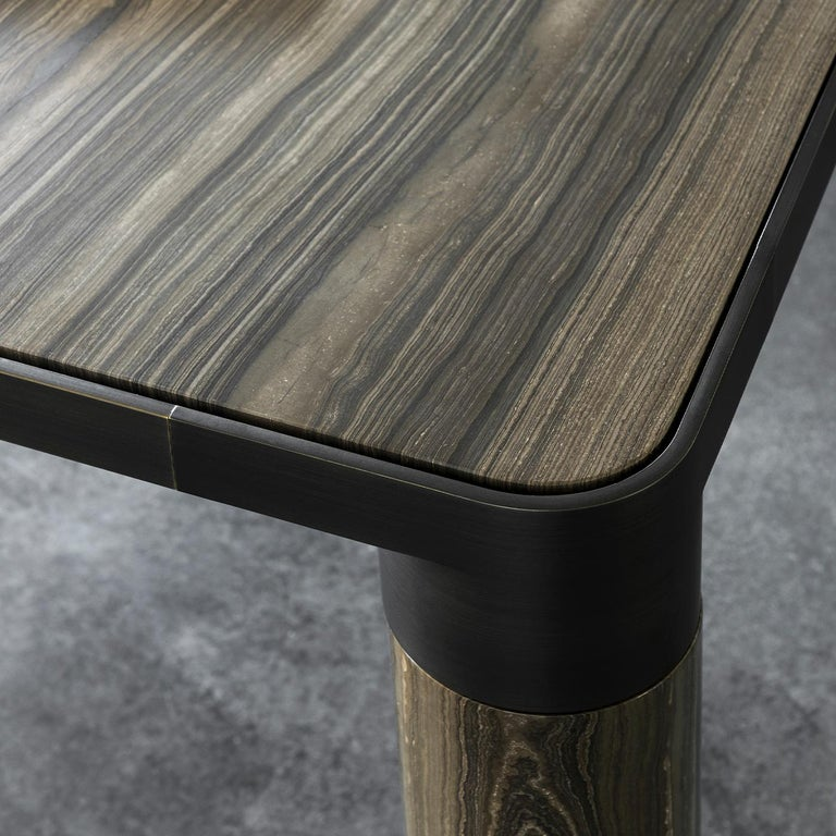 A superb showcase of craftsmanship, this dining table will fit perfectly in any modern and contemporary home. Characterized by a clean and essential design, it is entirely fashioned of Eramosa brown marble showcasing natural hues and veining, and