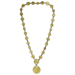 Bold Gold Long Sautoir Necklace with Patterned Discs by Cartier, circa 1960s