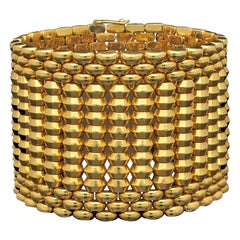 Bold Retro Wide 18 Karat Gold Bracelet of Highly Flexible Design, circa 1950s