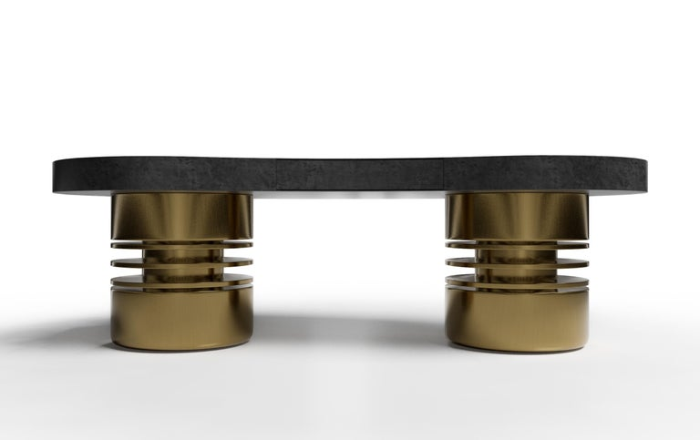 The Bolsa desk sends a strong statement of form and function. With unique cylindrical bases and a luxurious desktop, the Bolsa desk will be the jewel of any room. The Bolsa desk is offered in a variety of woods and finishes and is shown in opulent