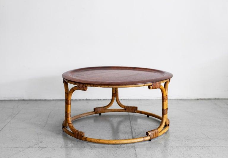 Italian coffee table by Bonacina with sculptural rattan base and circular wood top.
