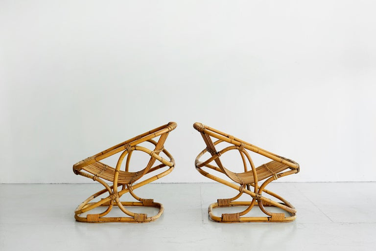 Italian rattan chairs by Bonacina Sculptural shape  Set of 4 available, priced per pair.