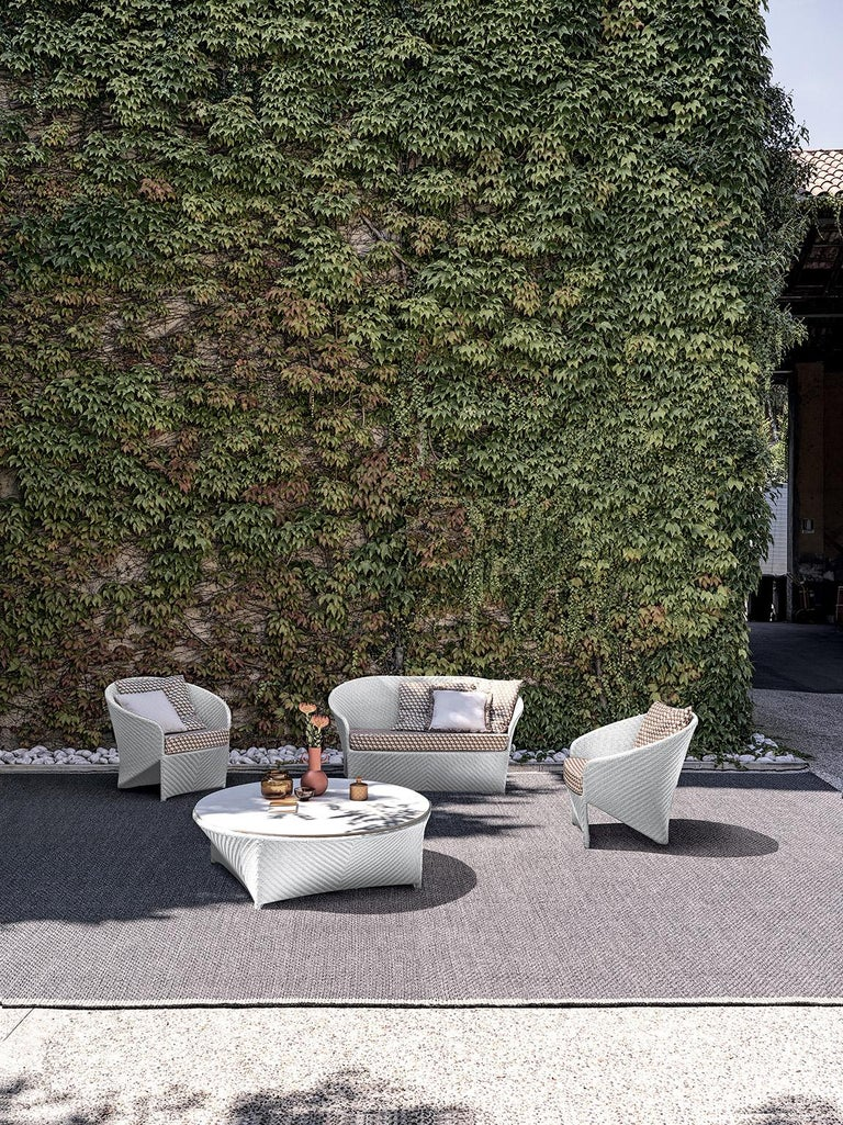 Design by Tito Agnoli for Bonacina 1889, 2007. A set of outdoor seatings studied to offer all the comfort one would expect from a typical indoor seating thanks to the powder-coated aluminium structure and the polypeel weaving. Weaved inpolypeel