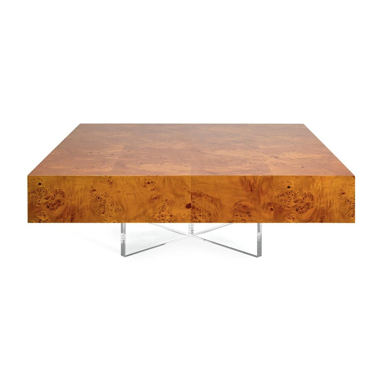 Timelessly chic. From our chic burled wood collection, pieced warm mappa wood floats atop a simple but glamorous X-shaped acrylic base. At 40 in. x 40 in., the bond cocktail table is squarely large-and-in-charge. Pared down enough for a Tribeca