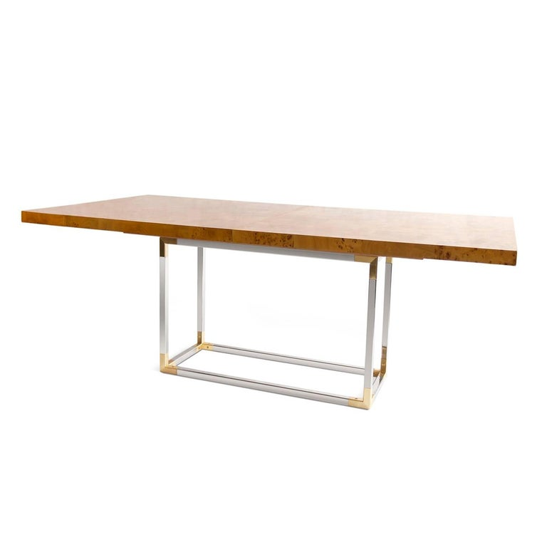 Timelessly chic. From our chic burled wood collection, a Minimalist dining table that feels organic, worldly, and wonderfully warm. Naturally honey-hued, pieced mappa wood is treated to a durable satin matte finish and set atop a polished nickel