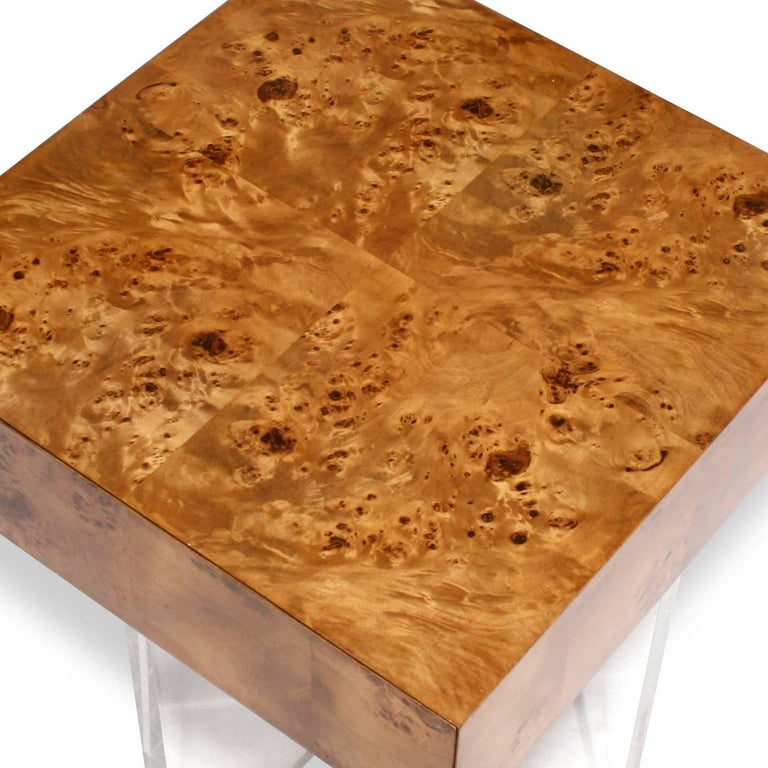 Timelessly chic. A Minimalist world of burled wood, acrylic panels, and stainless steel. Pieced, burled mappa wood floats atop a simple but glamorous acrylic base. Fully finished drawers with a hidden pull and a finished back make this piece fierce