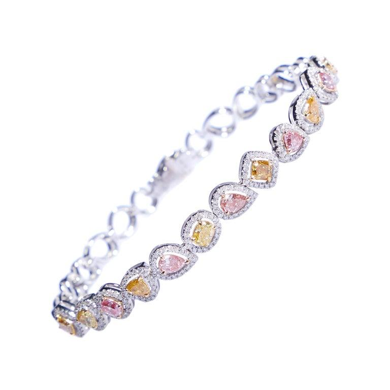 Fancy Colored Diamond Bracelet in 18 Karat White Gold For Sale