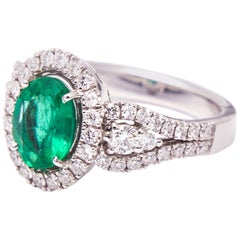 White Gold Engagement Ring with 1.50 Carat Oval Emerald and Diamonds