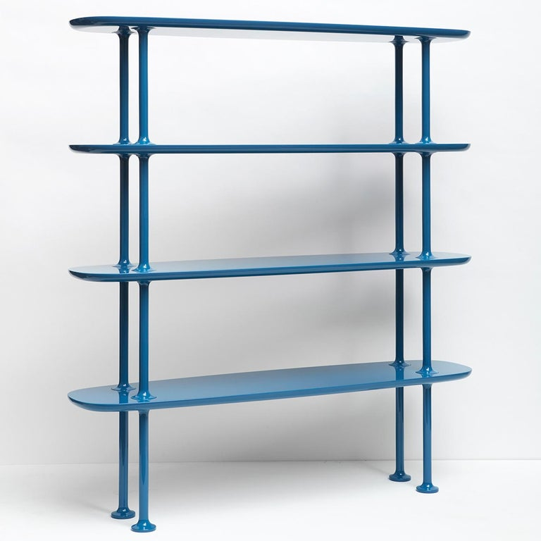 Defined by soft lines and visual lightness, the Bones Bookcase is carefully crafted of solid wood with a glossy cerulean lacquered finish that creates superb visual impact in a modern home or office decor. Four oblong shelves create a symmetrical