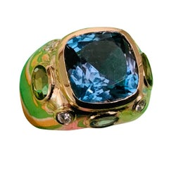 Bonheur Ring, Dark Blue Topaz, Peridot, Blue Topaz and Diamond Domed Ring