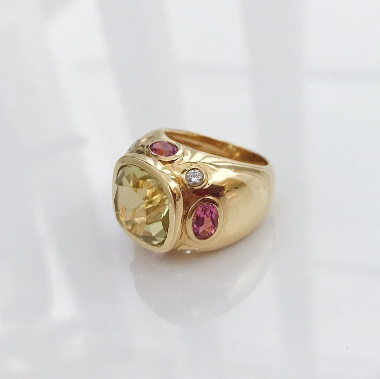 The BONHEUR Ring: 18kt Yellow Gold Domed Ring with faceted 15mm lemon Citrine cut center stone and faceted oval Pink Topaz stones and round Diamonds.   The ring measures 3/4 of an inch across the top.  This ring is available in any color stone