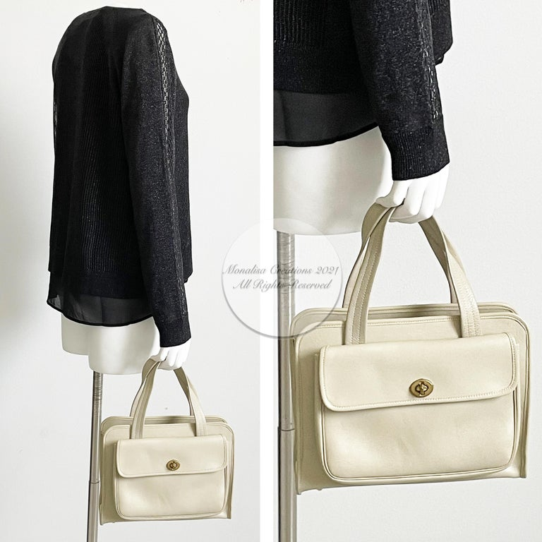 Authentic, preowned, vintage 60s Bonnie Cashin Coach Safari Bag Double Turnlock Pocket Tote. Super rare bag! Bone leather/striped fabric lined interior bottom. Preowned/vintage (50+ yrs old) w/signs of prior use & wear: rubs/marks to bottom & corner