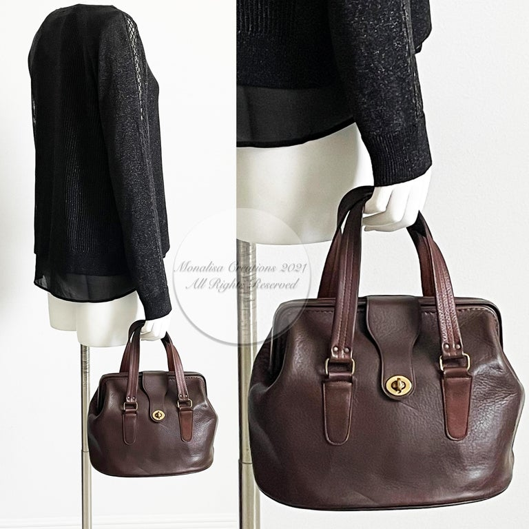 Authentic, preowned, 60s vintage Bonnie Cashin for Coach 'Super Hero Lunch Box' aka hinged doctors bag in mahogany leather. A true collectors piece.  A similar model is documented in Dr. Stephanie Lake's 'CHIC IS WHERE YOU FIND IT