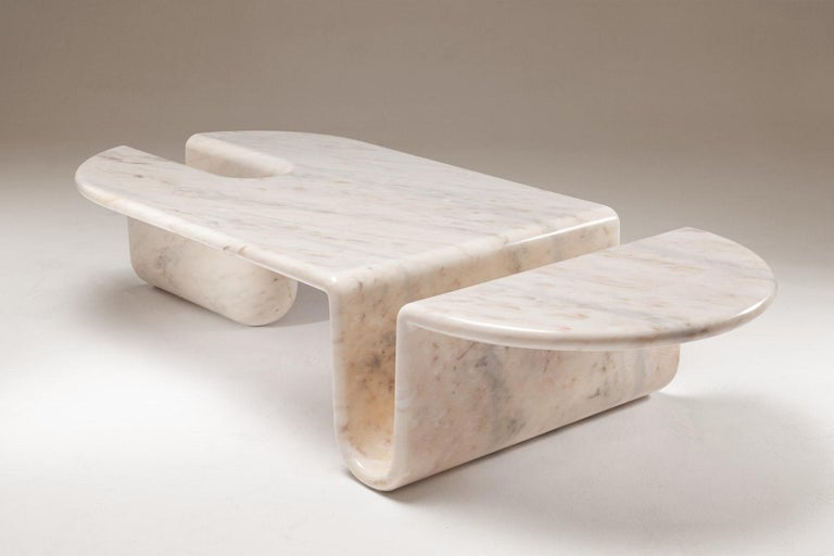 """Bonnie and Clyde center table by Dooq Measures: W 160 cm 63"""" D 70 cm 28"""" H 35 cm 14""""  Materials: Structure carved from one solid marble piece  Dooq is a design company dedicated to celebrate the luxury of living. Creating designs that"""