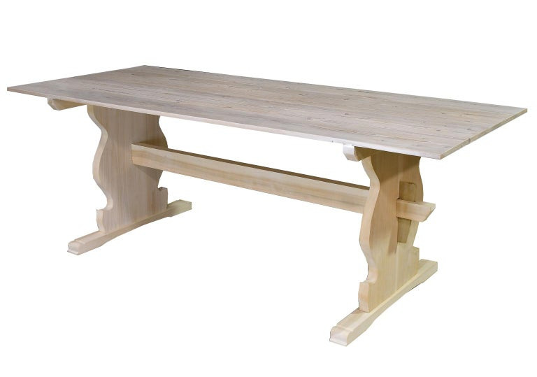 A Bonnin Ashley custom made, dining table with trestle base, and tongue-and-groove plank-top made from repurposed European pine. This Scandinavian-inspired table can be made in any size up to 10' long. Additionally, we offer a variety of styles for