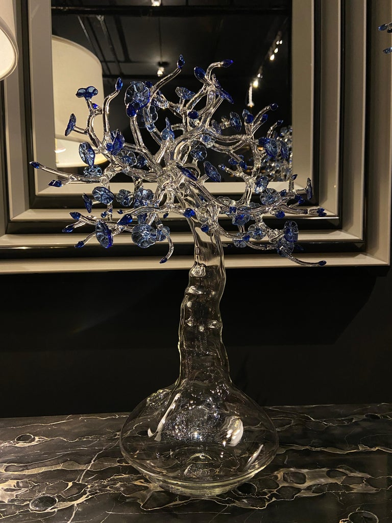 Fire-worked clear and blue borosilicate glass in the form of a miniature tree set atop a bulbous base. Signed and dated on the trunk.