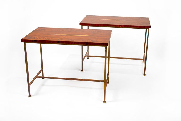 Rare side tables with beautiful bookmatched rosewood tops and brass frames designed by Paul McCobb for Calvin, 1952.