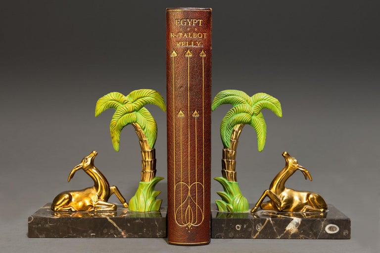 1 Volume. R. Talbot Kelly. Egypt. Painted & Described. Bound in full Wine Morocco with a painted on vellum on the front cover by Cedric Chivers, top edges gilt, gilt on covers & spine, illustrated with colored plates. Published: London: Adam &