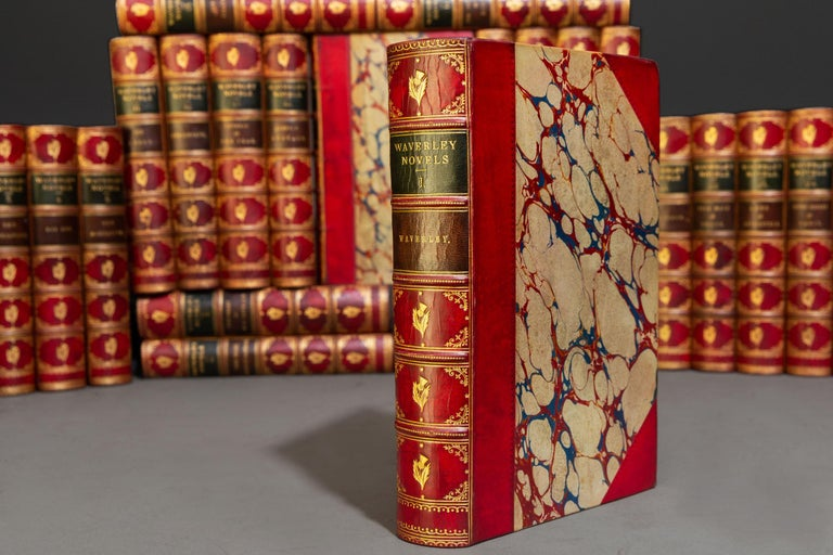 (Book Sets) 25 Volumes. Sir Walter Scott. Waverley Novels. Bound in 3/4 red calf, marbled boards, marbled edges and endpapers, raised bands, ornate gilt on spines, red and green labels on spines. Illustrated. Published: Edinburgh: Adam & Charles