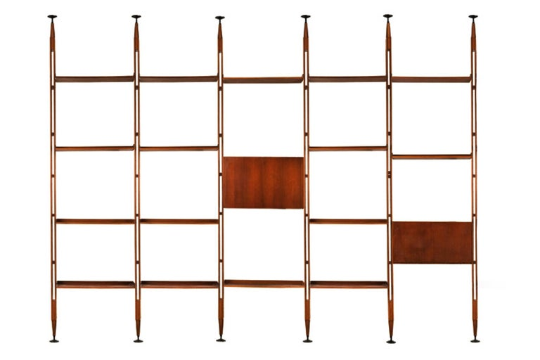 Bookcase structure composed of rosewood with black-painted aluminum brackets on top and bottom, supporting two cabinets and adjustable shelves. Literature: Giuliana Gramigna's Repertorio del Design Italiano 1950-2000, Vol. I, Milano, 1985, model