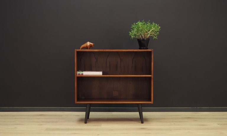 Classic bookcase from the 1960s-1970s, Minimalist form, Danish design. Surface of the furniture finished with rosewood veneer. Shelf with adjustable height. Maintained in good condition (minor bruises and scratches) - directly for