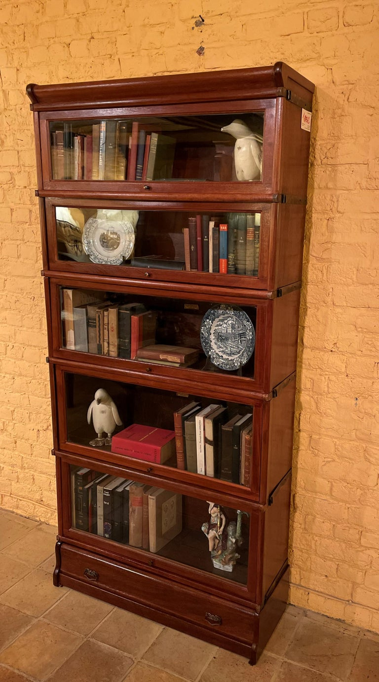 A fine globe wernicke bookcase called stacking bookcase from the end of the 19th-beginning of the 20th century in mahogany-England The bookcase is composed of 7 elements which are superimposed which facilitate transport The bookcase has a drawer
