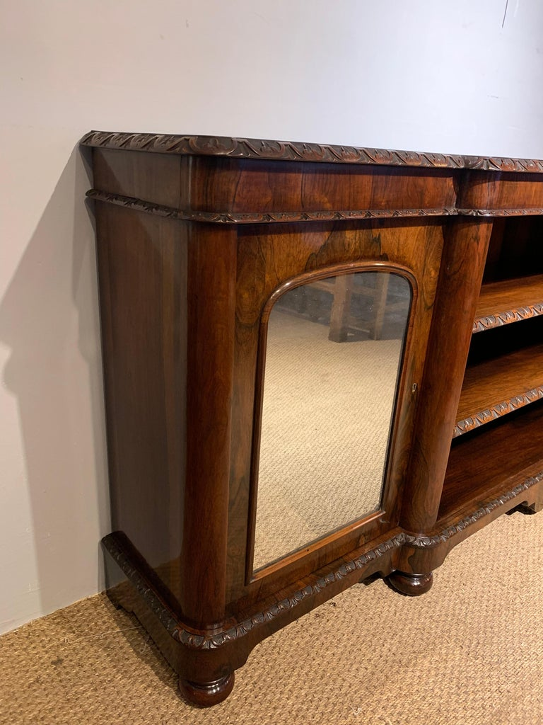 Very good quality mid Victorian long and low bookcase   English Dating to circa 1860s, having been through our workshops. Been cleaned / polished original mirrors to the cupboards, working locks and key   The 2 central shelves are fully