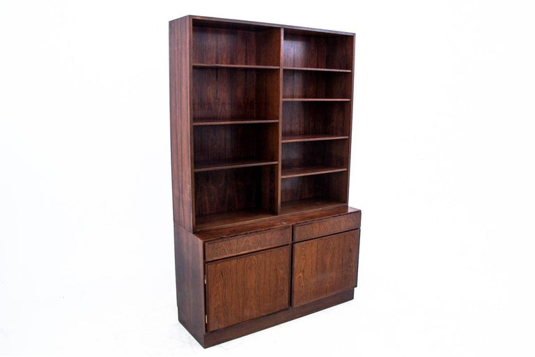 Bookcase from the 1960s. Furniture produced in the 1960s. Very good condition. Dimensions: H 187 cm / W 120 cm / D. 43 cm.