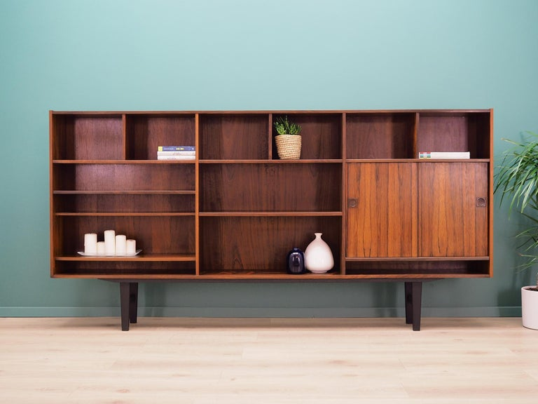 Bookcase was made in the 1960s by the well-known Danish furniture producer Farsø Møbelfabrik.