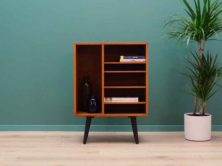 Unusual bookcase, library from the 1960s-1970s. Danish design, Minimalist form. The surface of the furniture finished with teak veneer. Shelves with height adjustment. Preserved in good condition (small bruises and scratches), directly for