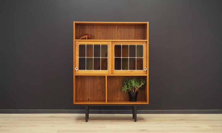 Phenomenal bookcase - library from the 1960s-1970s, minimalistic form, Danish design. Furniture finished with teak veneer. Doors decorated with stained glass. Preserved in good condition (minor bruises and scratches) - directly to
