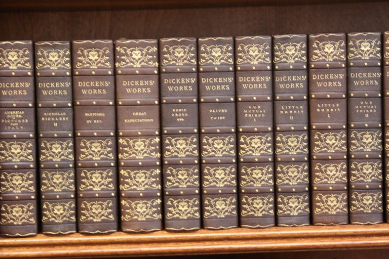 Thirty volumes. The complete writing of Charles Dickens, Published: London and Philadelphia, Chapman and Hall and J.B. Lippincott Company, circa 1900. Beautifully bound in antique dark brown morocco leather, spine gilt of gold with floral