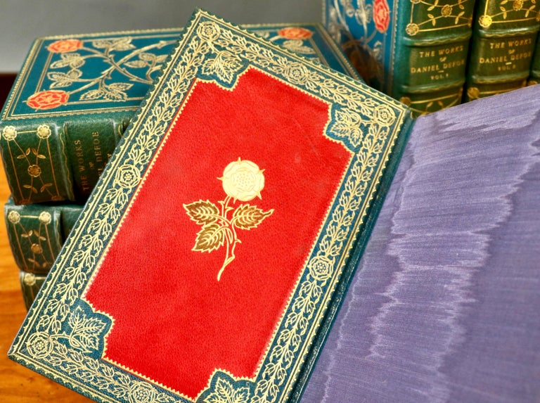 Daniel Defoe, complete works. Handmade Edition, limited to 150 copies. 16 volumes Magnificently bound in full turquoise Morocco, ornate gilt tooling of red and yellow roses on covers and spines, silk and leather doublers, illustrated. Pub. New