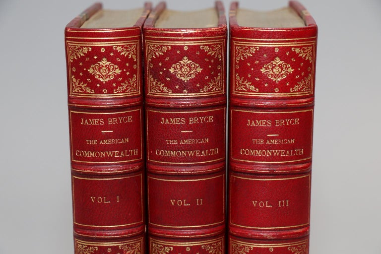 3 volumes: 'The National Government', 'The State Government', and 'The Party System & Public Opinion'. First edition! Bound in 3/4 red Morocco with marbled boards, top edges gilt, raised bands, & ornate gilt on spines. Published in London by